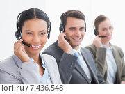 Купить «Business people with headsets using computers», фото № 7436548, снято 17 марта 2015 г. (c) Wavebreak Media / Фотобанк Лори