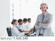 Купить «Businessman with executives using computers», фото № 7438348, снято 17 марта 2015 г. (c) Wavebreak Media / Фотобанк Лори