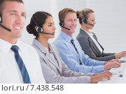 Купить «Business team working on computers and wearing headsets», фото № 7438548, снято 18 марта 2015 г. (c) Wavebreak Media / Фотобанк Лори