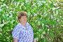 Пожилая женщина в природе рядом с цветущей черемухой, фото № 7451180, снято 8 мая 2015 г. (c) Володина Ольга / Фотобанк Лори