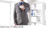Купить «close up of businessman showing white blank card», видеоролик № 7452616, снято 12 апреля 2015 г. (c) Syda Productions / Фотобанк Лори