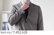 Купить «close up of man in suit adjusting necktie», видеоролик № 7452628, снято 12 апреля 2015 г. (c) Syda Productions / Фотобанк Лори