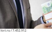 Купить «close up of businessman taking money bribe», видеоролик № 7452912, снято 12 апреля 2015 г. (c) Syda Productions / Фотобанк Лори