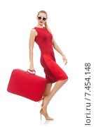 Купить «Pretty young woman in red dress isolated on white», фото № 7454148, снято 17 декабря 2014 г. (c) Elnur / Фотобанк Лори