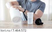 Купить «close up of man with protein shake bottle and jar», видеоролик № 7464572, снято 16 мая 2015 г. (c) Syda Productions / Фотобанк Лори