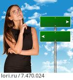 Купить «Задумавшаяся деловая женщина в черном платье стоит на фоне неба и двух знаков со стрелками в разные стороны», фото № 7470024, снято 18 февраля 2019 г. (c) Кирилл Черезов / Фотобанк Лори