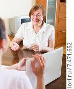 Купить «Positive mature woman answer questions», фото № 7471652, снято 21 ноября 2019 г. (c) Яков Филимонов / Фотобанк Лори