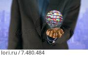 Купить «Ball made of European nationals flags turning on businessman hands », видеоролик № 7480484, снято 19 июня 2019 г. (c) Wavebreak Media / Фотобанк Лори