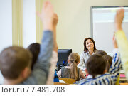 Купить «group of school kids raising hands in classroom», фото № 7481708, снято 15 ноября 2014 г. (c) Syda Productions / Фотобанк Лори