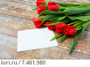 Купить «close up of red tulips and blank paper or letter», фото № 7481980, снято 3 марта 2015 г. (c) Syda Productions / Фотобанк Лори