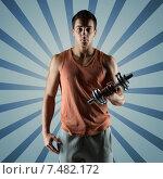 Купить «young man with dumbbell flexing biceps», фото № 7482172, снято 22 сентября 2014 г. (c) Syda Productions / Фотобанк Лори
