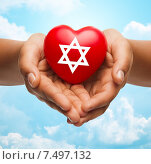 Купить «close up of hands holding heart with jewish star», фото № 7497132, снято 12 декабря 2013 г. (c) Syda Productions / Фотобанк Лори
