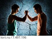 Купить «two young men arm wrestling», фото № 7497196, снято 22 сентября 2014 г. (c) Syda Productions / Фотобанк Лори