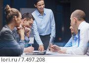 Купить «smiling female boss talking to business team», фото № 7497208, снято 9 ноября 2013 г. (c) Syda Productions / Фотобанк Лори