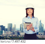 Купить «young smiling businesswoman in white helmet», фото № 7497432, снято 20 декабря 2013 г. (c) Syda Productions / Фотобанк Лори