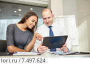 Купить «smiling businesspeople with tablet pc in office», фото № 7497624, снято 25 октября 2014 г. (c) Syda Productions / Фотобанк Лори