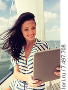 Купить «smiling woman sitting on yacht with tablet pc», фото № 7497708, снято 13 июля 2014 г. (c) Syda Productions / Фотобанк Лори