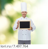 Купить «happy male chef cook holding blank menu board», фото № 7497764, снято 7 марта 2015 г. (c) Syda Productions / Фотобанк Лори