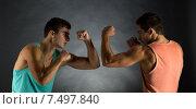 Купить «young men wrestling», фото № 7497840, снято 22 сентября 2014 г. (c) Syda Productions / Фотобанк Лори