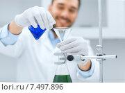 Купить «close up of scientist with test tubes and funnel», фото № 7497896, снято 4 декабря 2014 г. (c) Syda Productions / Фотобанк Лори