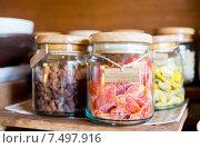 Купить «close up of jars with dried fruits at grocery», фото № 7497916, снято 15 февраля 2015 г. (c) Syda Productions / Фотобанк Лори