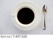 Купить «cup of black coffee with spoon and saucer on table», фото № 7497928, снято 21 февраля 2015 г. (c) Syda Productions / Фотобанк Лори
