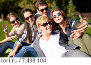 Купить «students or teenagers with smartphone at campus», фото № 7498104, снято 15 сентября 2013 г. (c) Syda Productions / Фотобанк Лори