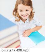 Купить «smiling little student girl with many books», фото № 7498420, снято 31 июля 2013 г. (c) Syda Productions / Фотобанк Лори
