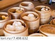 Купить «meat or rice balls in wooden containers», фото № 7498632, снято 15 февраля 2015 г. (c) Syda Productions / Фотобанк Лори