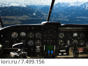 Купить «dashboard in airplane cockpit and mountains view», фото № 7499156, снято 14 февраля 2014 г. (c) Syda Productions / Фотобанк Лори
