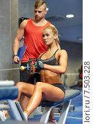 Купить «man and woman flexing muscles on gym machine», фото № 7503228, снято 19 апреля 2015 г. (c) Syda Productions / Фотобанк Лори