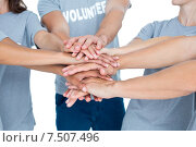 Купить «Volunteers friends putting their hands together», фото № 7507496, снято 19 марта 2015 г. (c) Wavebreak Media / Фотобанк Лори