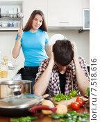 Купить «Unhappy man with angry wife at home», фото № 7518616, снято 12 марта 2014 г. (c) Яков Филимонов / Фотобанк Лори