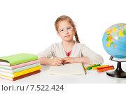 Купить «Школьница пишет в тетради за столом с учебниками и глобусом», фото № 7522424, снято 16 мая 2015 г. (c) Юлия Кузнецова / Фотобанк Лори