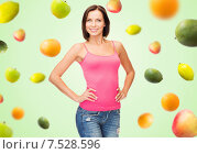 Купить «woman in blank pink tank top over fruits on green», фото № 7528596, снято 25 июля 2013 г. (c) Syda Productions / Фотобанк Лори