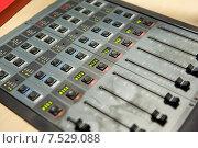 Купить «control panel at recording studio or radio station», фото № 7529088, снято 8 апреля 2015 г. (c) Syda Productions / Фотобанк Лори