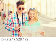 Купить «smiling couple with map and photo camera in city», фото № 7529172, снято 7 июля 2014 г. (c) Syda Productions / Фотобанк Лори