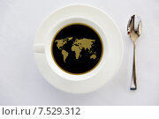 Купить «world map in cup of black coffee with spoon», фото № 7529312, снято 21 февраля 2015 г. (c) Syda Productions / Фотобанк Лори