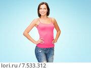 Купить «happy young woman in blank pink tank top over blue», фото № 7533312, снято 25 июля 2013 г. (c) Syda Productions / Фотобанк Лори