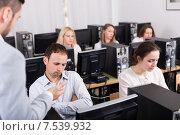 Купить «boss and clerk at open space working area», фото № 7539932, снято 19 октября 2018 г. (c) Яков Филимонов / Фотобанк Лори
