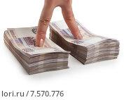 Купить «Два пальца руки на стопках бумажных российских денег», фото № 7570776, снято 23 октября 2014 г. (c) Элина Гаревская / Фотобанк Лори