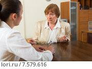 Купить «Two adult businesswomen in the office», фото № 7579616, снято 23 февраля 2019 г. (c) Яков Филимонов / Фотобанк Лори