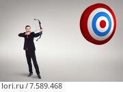 Купить «Composite image of focused businessman shooting a bow and arrow», фото № 7589468, снято 25 марта 2019 г. (c) Wavebreak Media / Фотобанк Лори