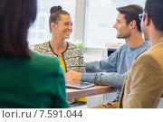 Купить «Smiling colleagues talking together», фото № 7591044, снято 22 марта 2015 г. (c) Wavebreak Media / Фотобанк Лори