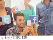 Купить «Colleagues holding sign from famous social networks», фото № 7592128, снято 22 марта 2015 г. (c) Wavebreak Media / Фотобанк Лори