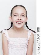 Купить «Восторженная девочка с косичками», фото № 7604108, снято 13 мая 2015 г. (c) Дмитрий Булин / Фотобанк Лори