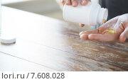 Купить «close up of man with fish oil capsules jar», видеоролик № 7608028, снято 16 мая 2015 г. (c) Syda Productions / Фотобанк Лори
