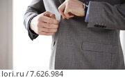 Купить «close up of man in suit fastening button on jacket», видеоролик № 7626984, снято 12 апреля 2015 г. (c) Syda Productions / Фотобанк Лори