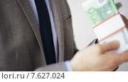 Купить «close up of businessman taking money bribe», видеоролик № 7627024, снято 12 апреля 2015 г. (c) Syda Productions / Фотобанк Лори