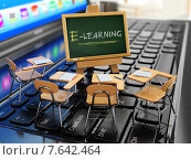 Купить «E-learning concept. Schooldesk and chalkboard on the laptop keyboard.», фото № 7642464, снято 15 августа 2018 г. (c) Maksym Yemelyanov / Фотобанк Лори